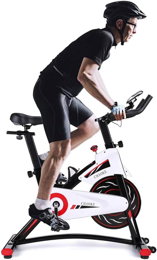 A user rides on the CHAOKE 8733 Indoor magnetic Exercise Bike while standing