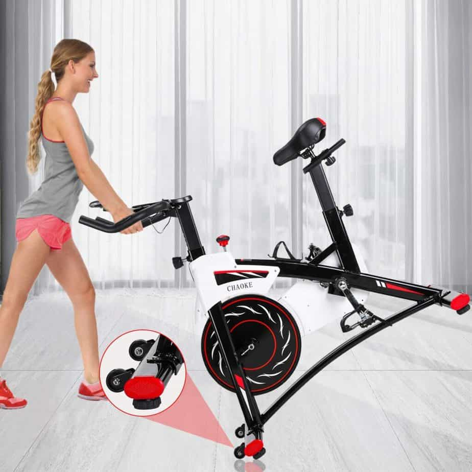 The CHAOKE 8733 Indoor magnetic Exercise Bike is being moved for storage