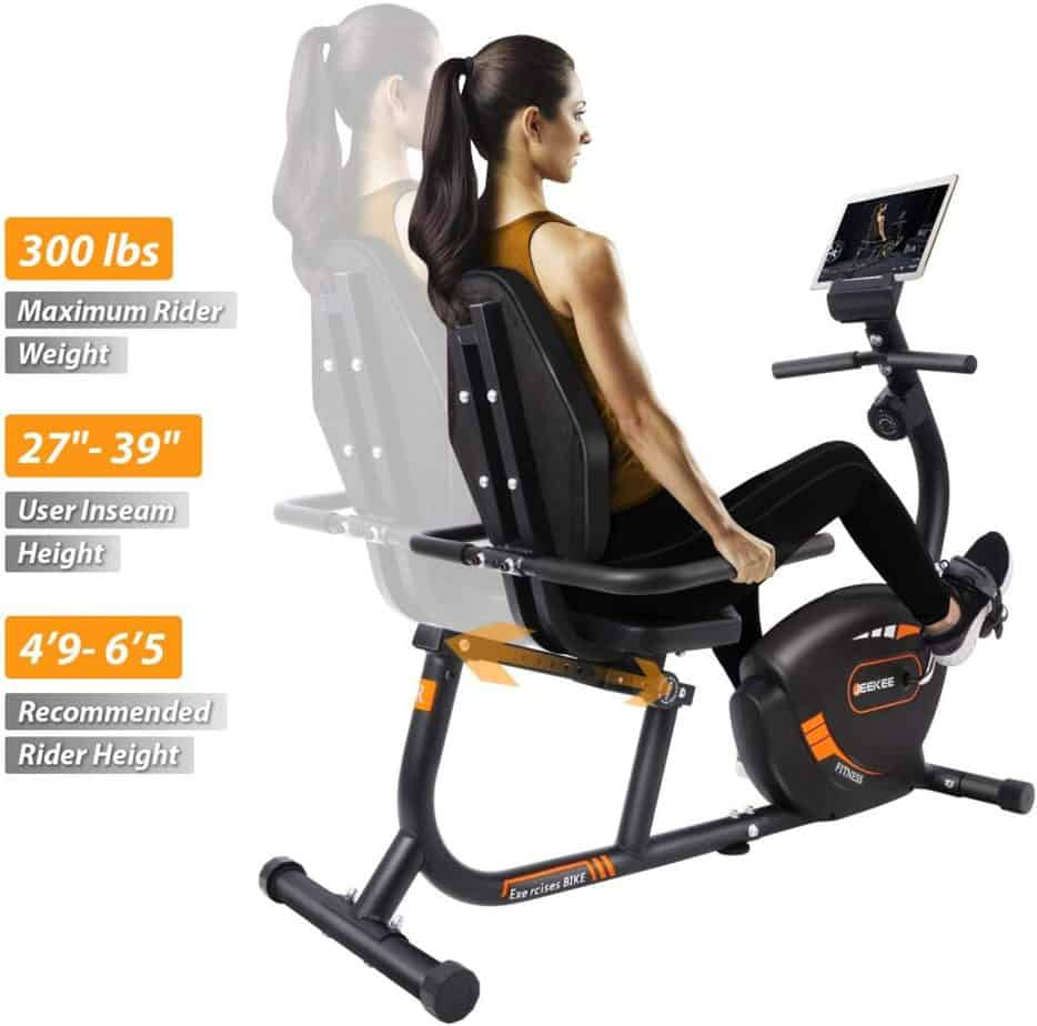 A woman exercises with the JEEKEE Magnetic Recumbent Exercise Bike