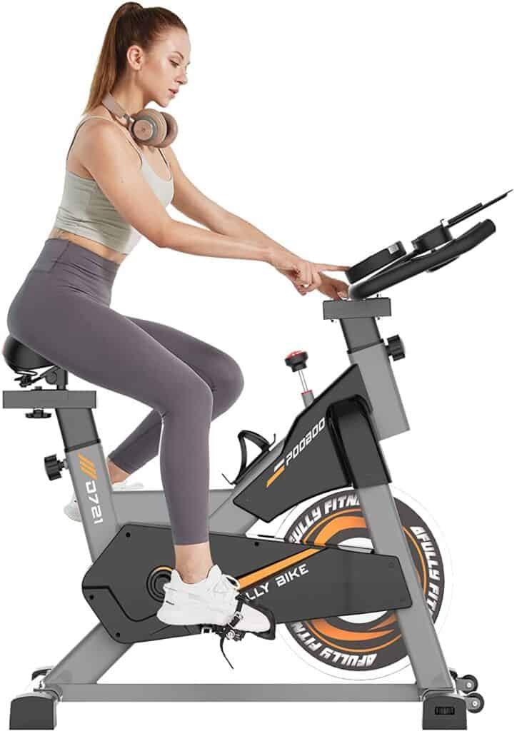 A lady exercises with the Pooboo S2 D721 Indoor Cycling Bike