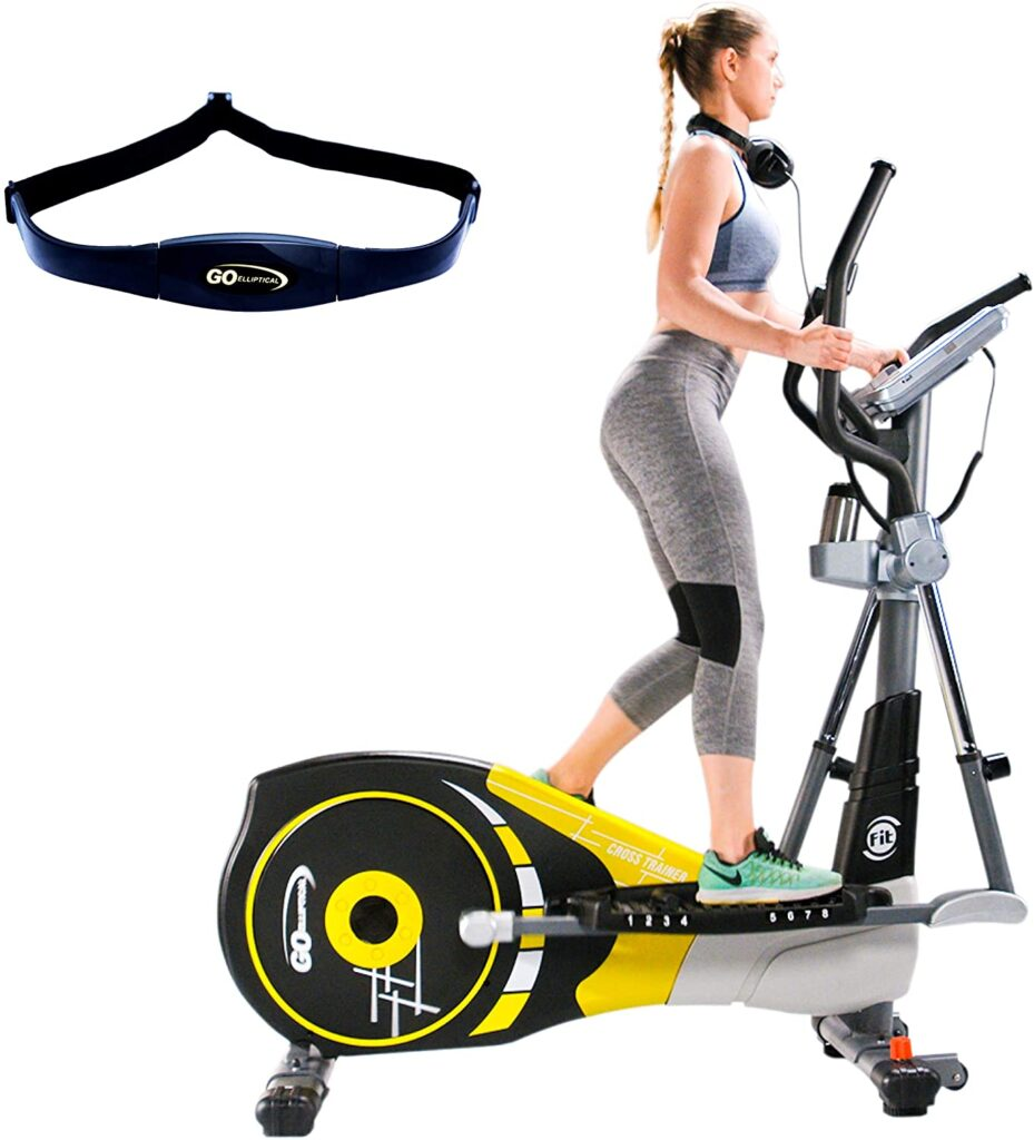 A lady exercises with the GOELLIPTICAL V-600X Elliptical Cross Trainer while HR rate chest strap is in display