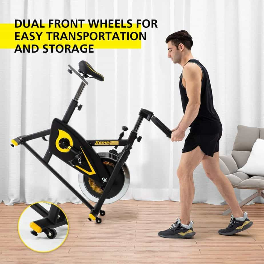 The XGEAR Magnetic Indoor Exercise Bike is being rolled away for storage