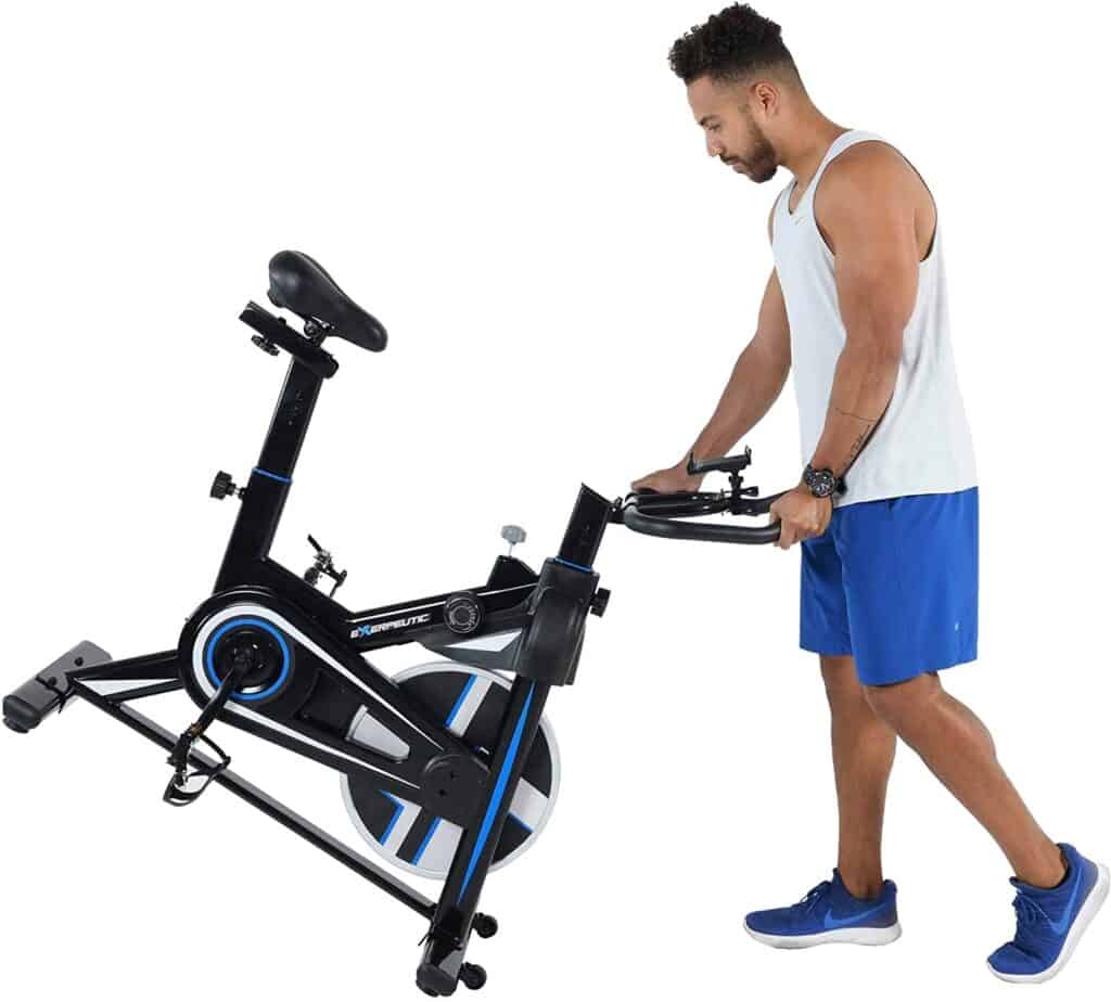 A user moves the Exerpeutic LX 3000 Indoor Cycling Exercise Bike (4210) for storage