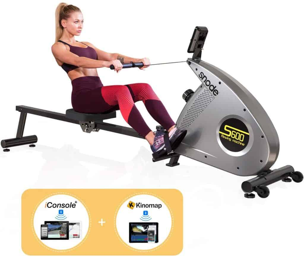A lady is exercising with the SNODE S600 Bluetooth Magnetic Rowing Machine