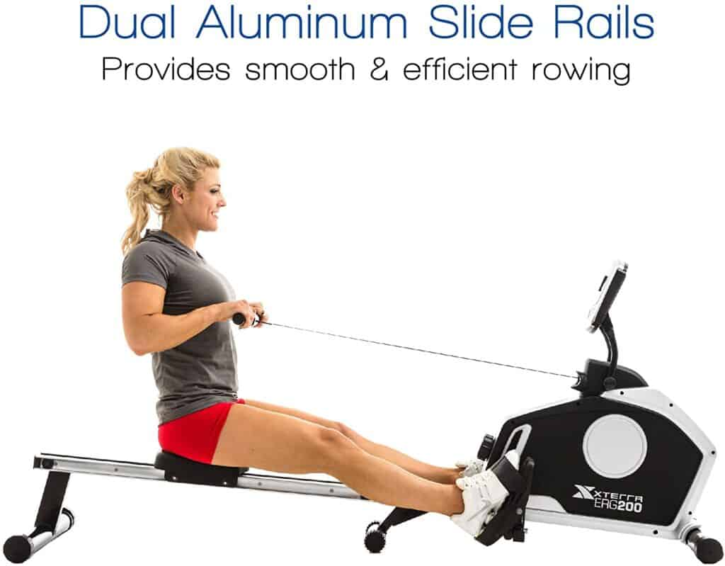 A lady exercises with the XTERRA Fitness ERG200 Magnetic Rowing Machine