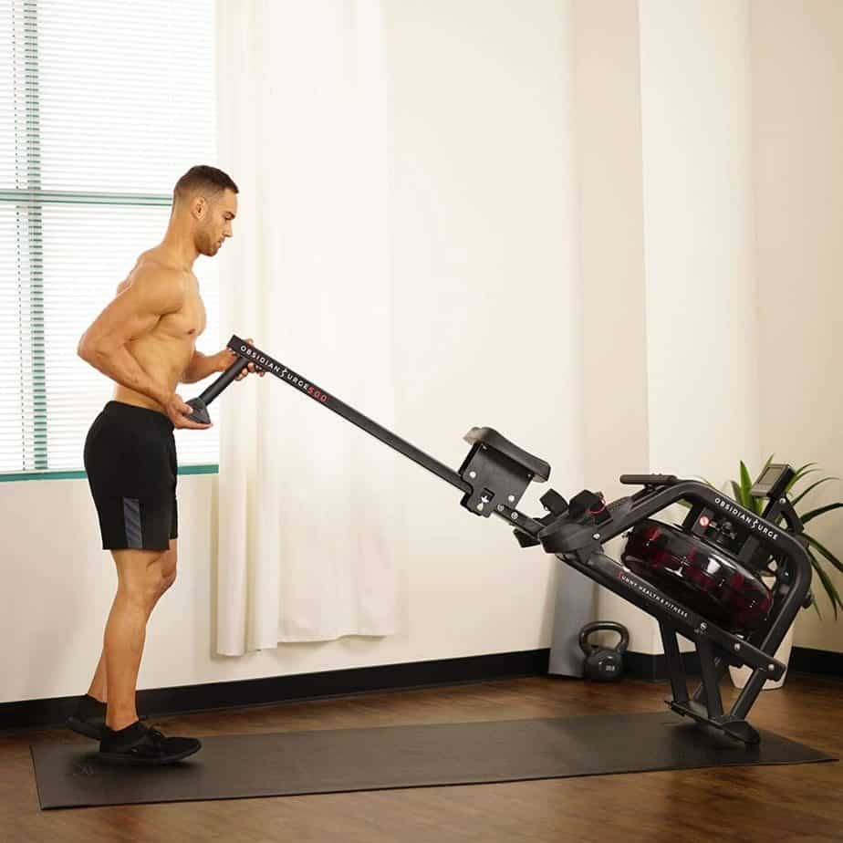 The Sunny Health & Fitness SF-RW5713 Obsidian Surge 500 Rowing Machine  is being moved for storage