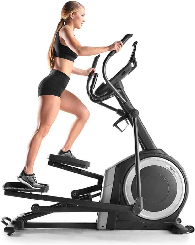A lady exercises with the NordicTrack NTEL71218 C 12.9 Elliptical Trainer