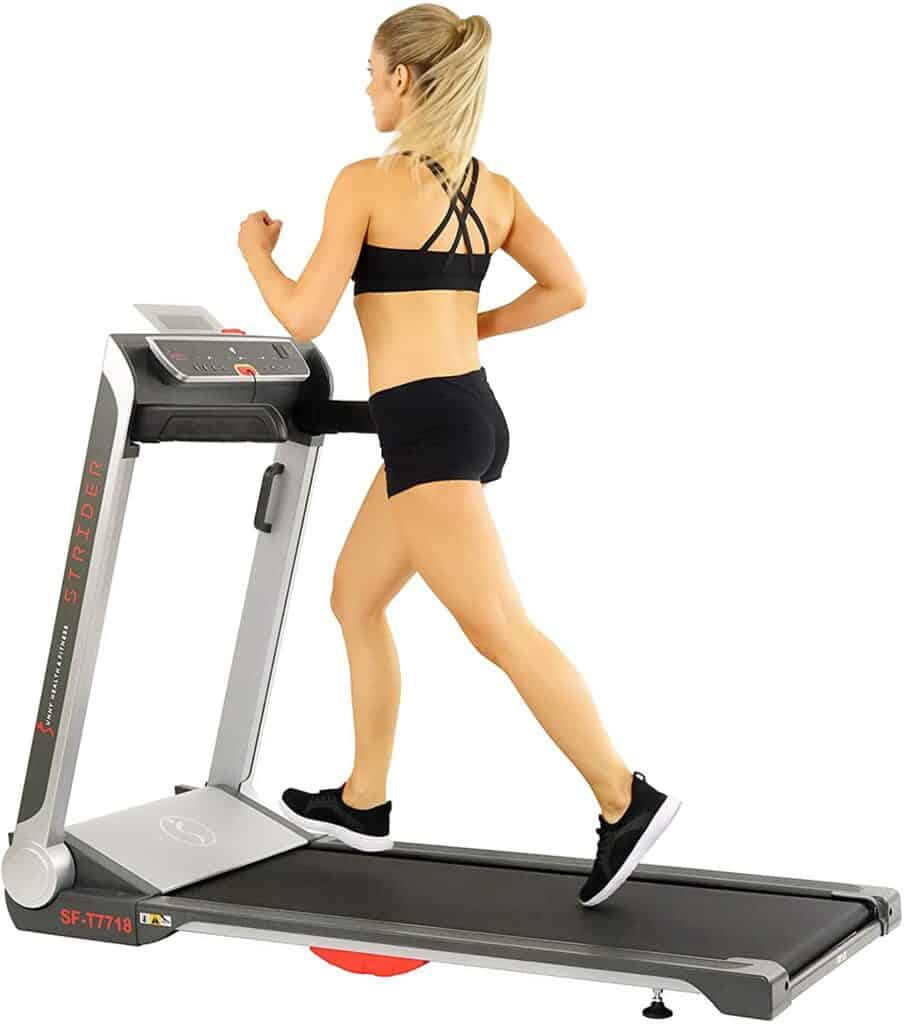 A lady exercises on the Sunny Health & Fitness SF-T7718 Electric Treadmill