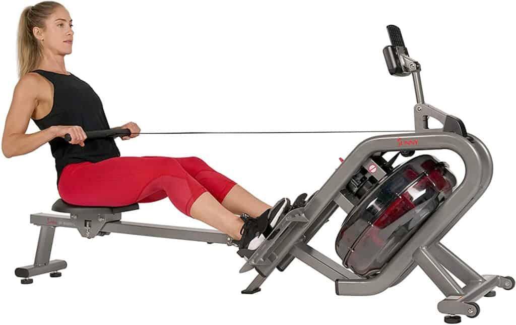 This woman uses the Sunny Health & Fitness SF-RW5910 Phantom Hydro Water Rower