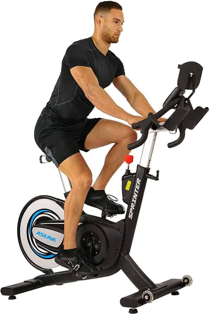 A man rides the Sunny Health & Fitness Asuna Sprinter 6100 Cycling Bike