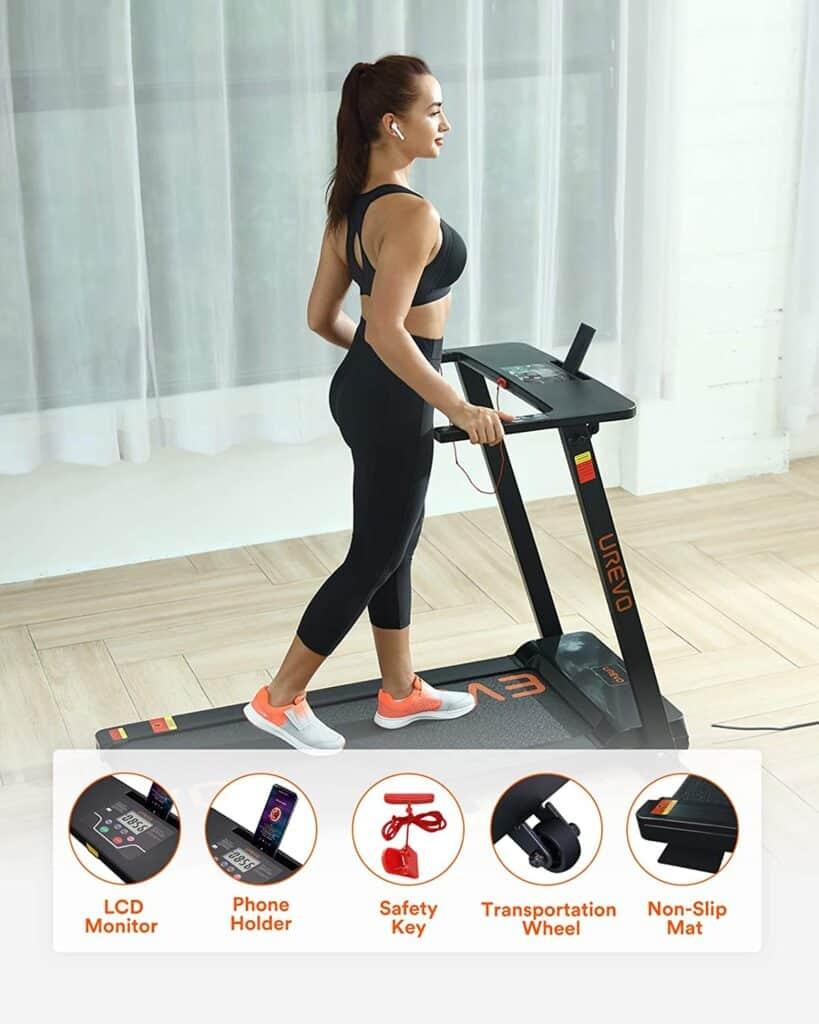 This lady walks on the UREVO Foldable Under-Desk 2.5 HP Treadmill