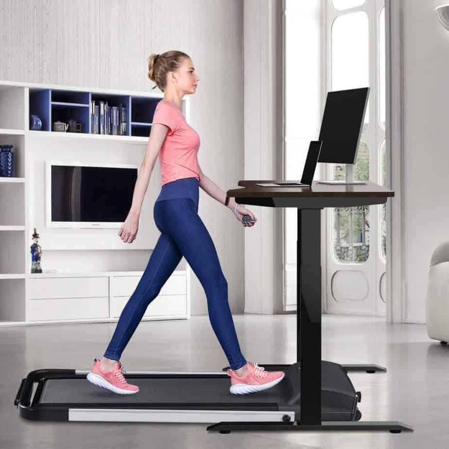 A lady uses the Estleys 2-in-1 Under-Desk Treadmill under a desk