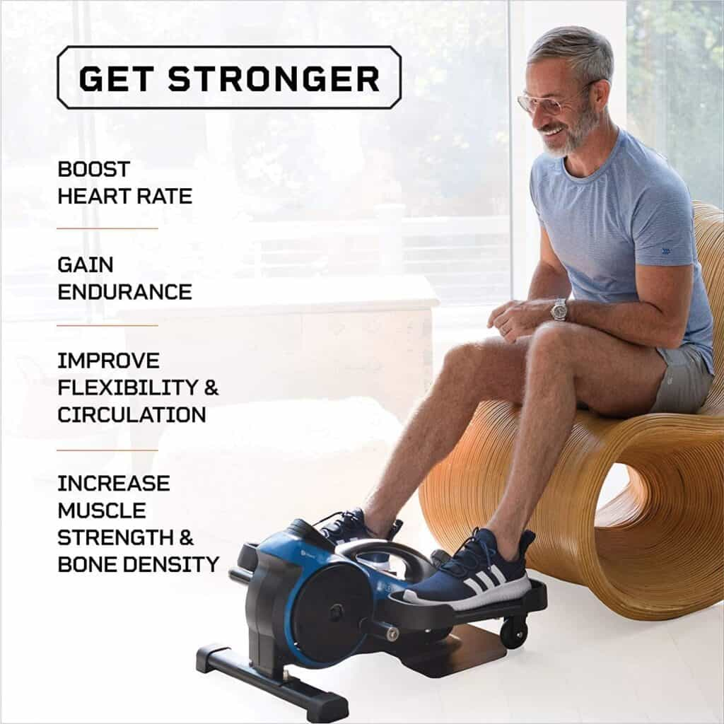 The elderly man exercises with the LifePro Under-Desk Elliptical Trainer