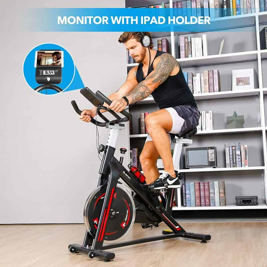 An athlete exercises with the TELESPORT Indoor Cycling Bike