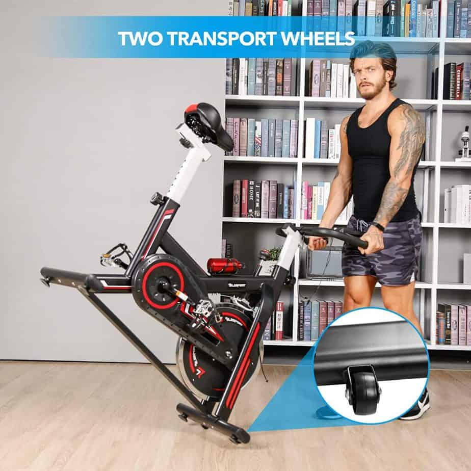 A user rolls the TELESPORT Indoor Cycling Bike away for storage