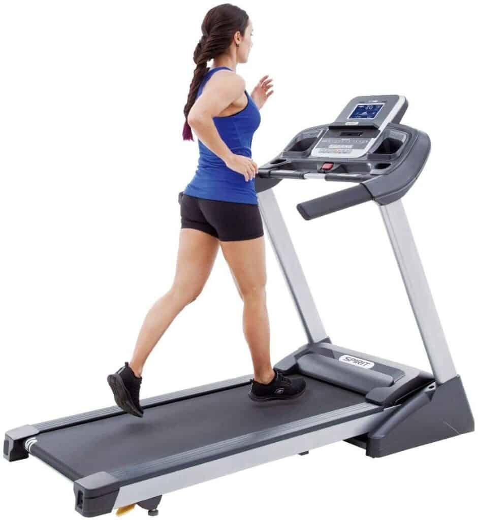 A lady runs on the Spirit Fitness XT185 Folding Treadmill