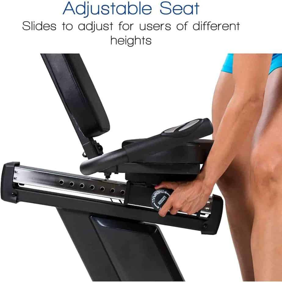 A user adjusts the seat of the XTERRA SB2.5R Exercise Recumbent Bike