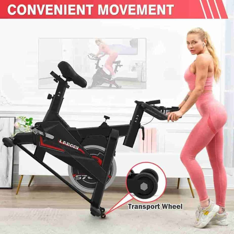 A lady rolls the LABODI Exercise Bike away for storage