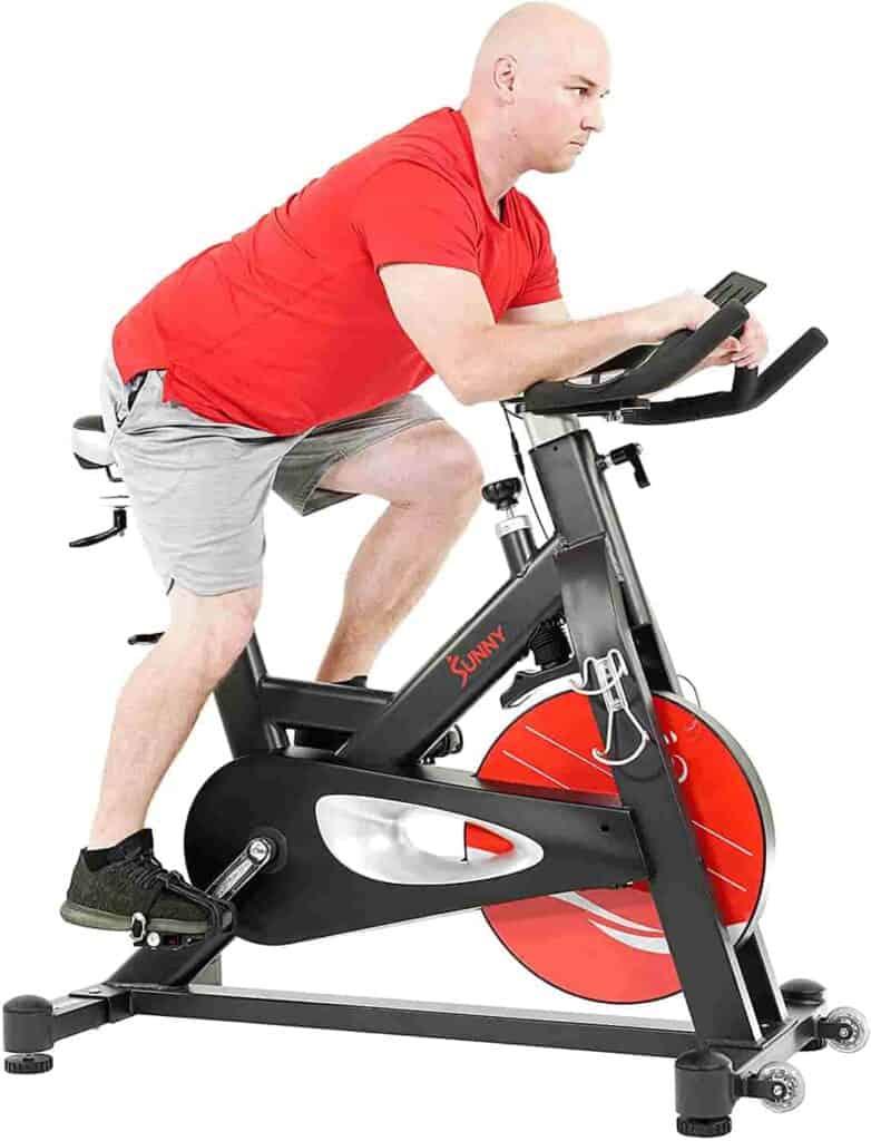 A man rides the Sunny Health & Fitness SF-B1986 Evolution Pro II Cycling Bike