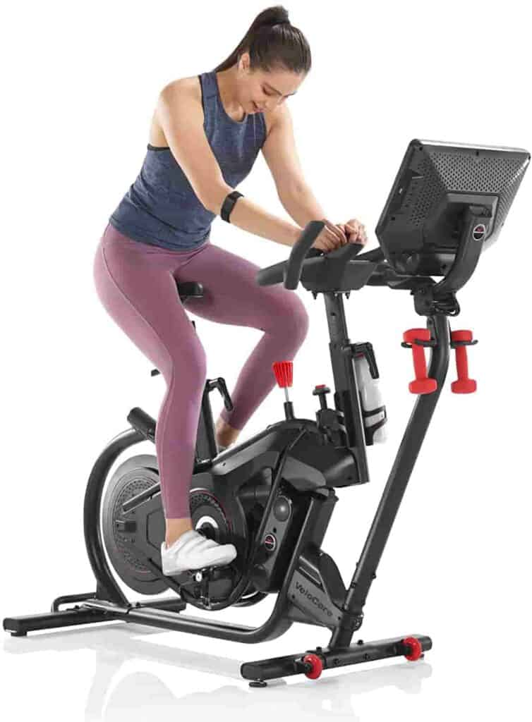 A lady exercises with the Bowflex VeloCore 16 IC Bike