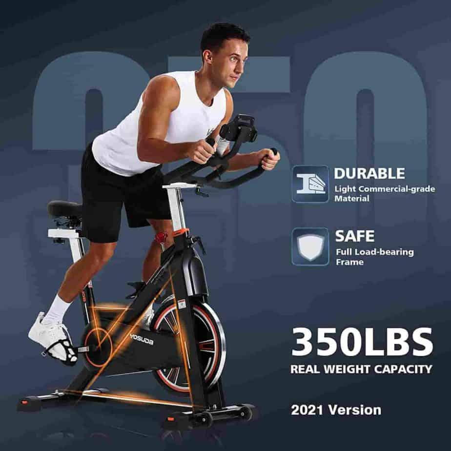 An athlete rides the YOSUDA L-010 Pro Magnetic Exercise Bike