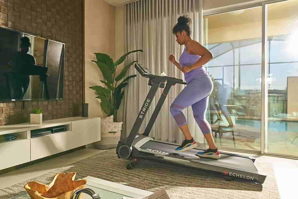 A lady runs on the Echelon Stride Treadmill