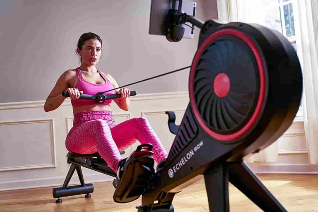 A woman exercises on the Echelon Smart Rowing Machine
