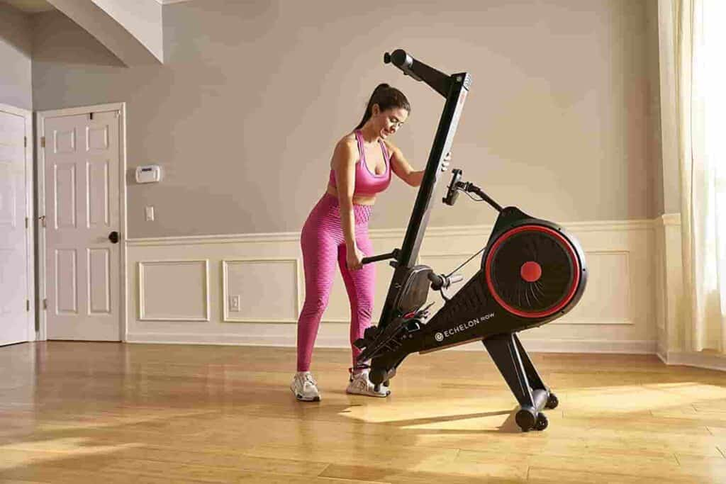 The Echelon Smart Rowing Machine is being fold up by the user